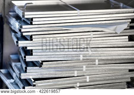 Galvanized Sheets Are Stacked In A Stack. Industrial Background. Close-up