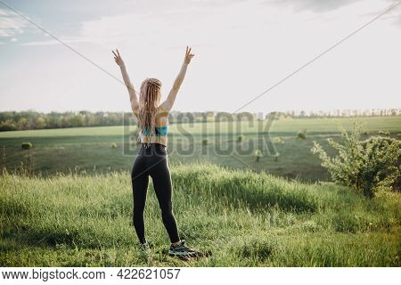 Sporty Fit Woman Raising Arms Express Positivity
