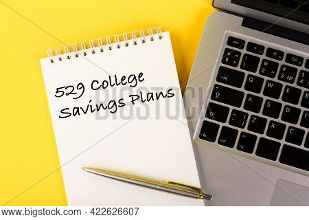 Text, 529 College Savings Plans, Education Loan, Written In A Notebook Lying On A Desk With A Notebo
