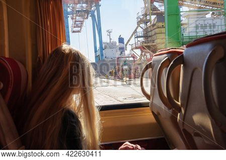 Cargo Port Through Window Of Touristic Bus. View To Container Terminal From Excursion Bus With Blurr