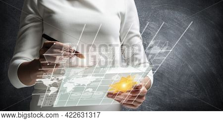 Woman Hand Touching Virtual Screen With Pen. Online Project Management And Financial Diagrams Visual