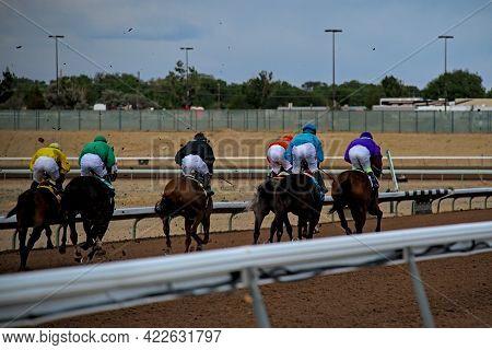 Jockeys Running Horses At Racetrack And Casino Trying To Win 6 Furlong Race With Quarterhorses For B