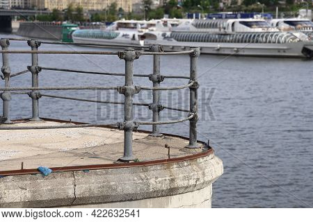 Krasnopresnenskaya Embankment With A Fence Against The Background Of The Pier With Pleasure Boats, M