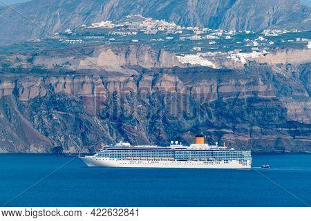 Cruise liner ship vessel in Aegean sea near Santorini island in Greece