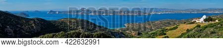 Scenic panorama of greek scenery - Aegean sea near Milos island on summer day in Greece with white orthodox christian greek church