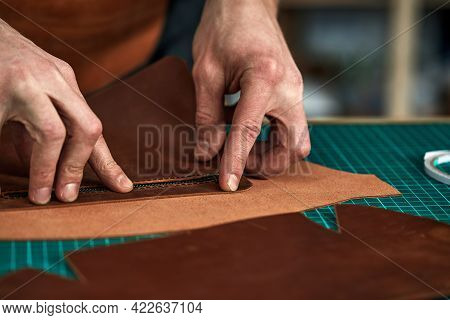 Tailors Hands A Purchase Plan, A Partner Tries On A Detail Of A Leather Product, A Leather Steam Roo