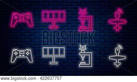 Set Line Solar Energy Panel, Microscope, Gamepad And Uav Drone. Glowing Neon Icon On Brick Wall. Vec