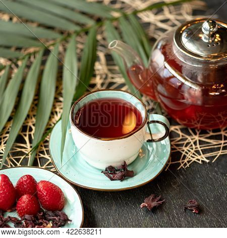 Red Berries And Herbal Tea, Glass Teapot Of Drink, Dry Hibiscus Or Chinese Rose Frowers And Fresh St