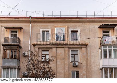 Sevastopol. Crimea. December 2020. A House With A Portrait Of Putin. A Faded Portrait Of The Preside