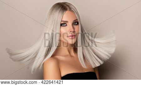 Beautiful Girl With Hair Coloring In Ultra Blond. Stylish Hairstyle Done In A Beauty Salon. Fashion,