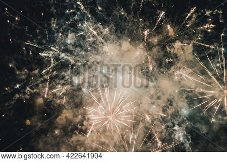 Abstract Photo Of Fireworks. Salute Without Focus. Blurry Photo. Festive Fireworks. A Beautiful Flic