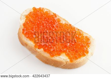 Bread with red salmon roe, close-up