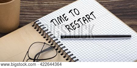 Time To Restart Words Written On Office Notebook. Concept Business.