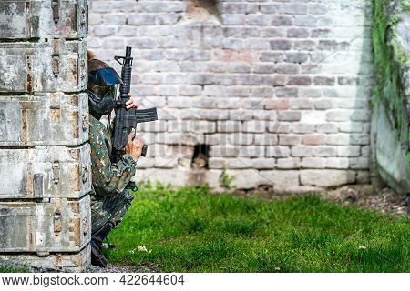 Woman In Uniform With A Gun In Military Paintball Training