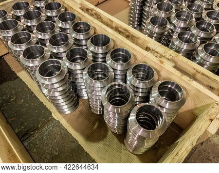 Stacks Of Batch Production Round Parts In A Wooden Boxes On Factory Floor