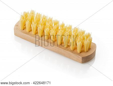 Close-up Of New Wooden Cleaning Brush With Coarse Stiff Yellow Bristles Isolated On White Background