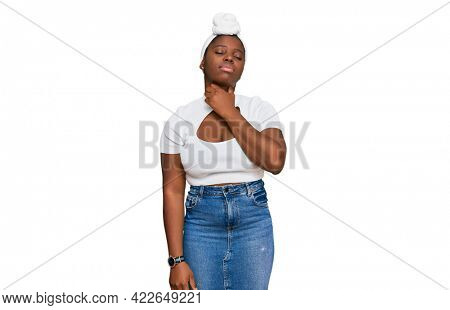 Young african woman with turban wearing hair turban over isolated background touching painful neck, sore throat for flu, clod and infection