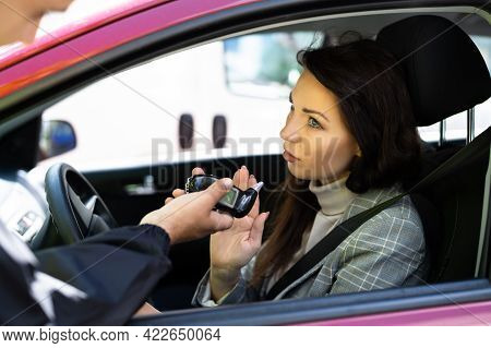 Woman Arguing And Refusing Driver Alcohol Test Using Breathalyzer