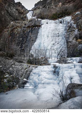 Ice Waterfall Between Rock Walls, In The Northern Hills Of Guadalajara, Despeñalagua Cascade, Valver