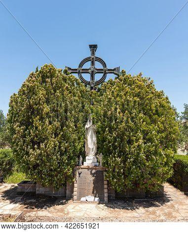 Santa Inez, Ca, Usa - April 3, 2009: San Lorenzo Seminary. White Statue Of Virgin Mary Partly Hidden