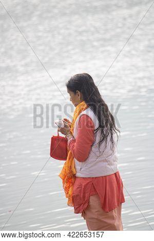 Haridwar, Uttarakhand, India, April 14, 2021.indian Woman Worship Holy River The Ganges At Haridwar