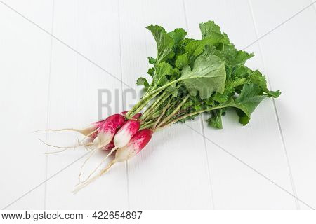 A Bunch Of Freshly Picked Radishes On A White Wooden Table. A Fresh Crop Of Radishes.