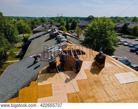Roof Shingles Need With New Shingles Of An Apartment Building Replacing A Gray Asphalt Tile