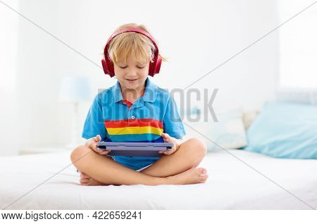 Child With Tablet Computer. Kids Study Online. Electronic Device For Learning And Studying At Home.