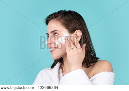 Beauty Portrait Of Beautiful Female Model Apply A Cleansing Mask On Face. Woman Apply Facial Cream L