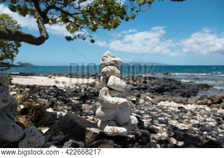 Balancing Pyramid Of Sea Pebbles On A Beach Background, The Concept Of Harmony And Balance. Stones B