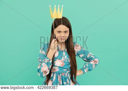 Angry Selfish Girl Hold Booth Crown Over Head Keeping Arm Akimbo Blue Background, Egoist