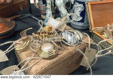 Antiques On Flea Market Or Festival - Close Up View Of Vintage Jewelry, Silver Brooches And Other Vi
