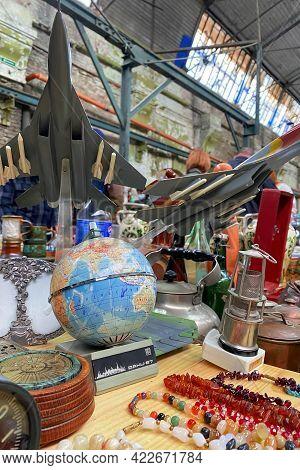 Lviv, Ukraine - May 31, 2021 : Different Antiques On Flea Market - Vintage Globe, Collectible Aircra
