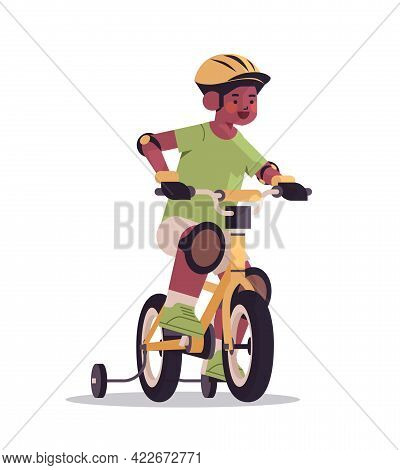 Little African American Boy In Helmet Riding Bike Childhood Concept Full Length Isolated Vertical