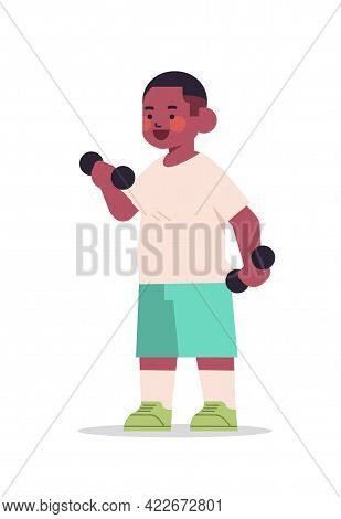 Little African American Boy Doing Physical Exercises With Dumbbells Healthy Lifestyle Childhood Conc