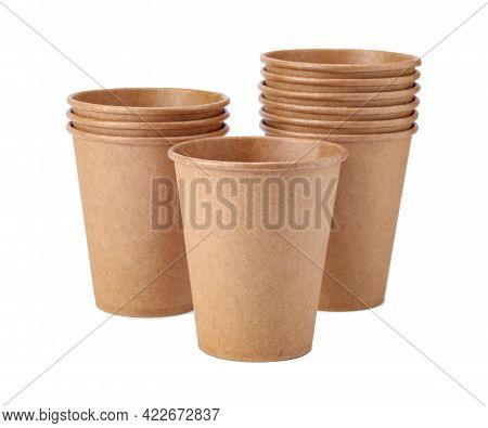 Ten Disposable Paper Cups Isolated On White Background. Eco Friendly Disposable Tableware From Natur