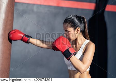 Asian Bodybuilder Beautiful Woman Athlete Wear Boxing Gloves, Doing Workout Exercise By Hitting A Pu