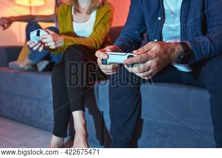 Couple Playing Video Games At Home And Having Fun. Friends Having Fun While Playing Video Games Hold