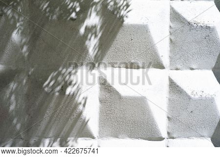 Surface Of The Concrete Fence In The Form Of A Pyramid, Painted In White Color, Close Up Of Details