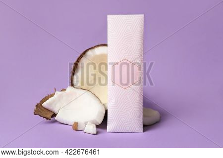 Scented Sachet And Pieces Of Coconut On Violet Background
