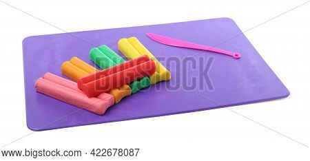 Many Different Colorful Plasticine Pieces And Sculpting Knife On White Background