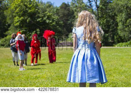 Alice In Wonderland Staging Scene In Outdoor Park Theater.