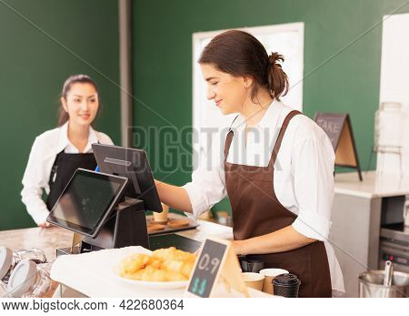 Beautiful Caucasian Barista Woman Happy To Make Online Coffee Orders On Cashier Machine At The Coffe