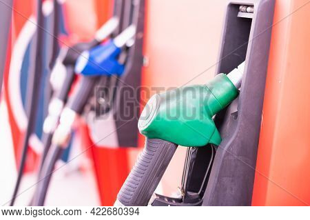 Close Up Green Fuel Nozzle On Tank Of Gas Station In Commercial Gas Station To Filling Power Oil Ene