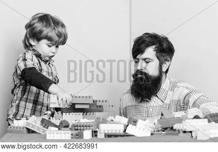 Child Care And Upbringing. Father Son Game. Father Son Create Constructions. Father And Boy Play Tog