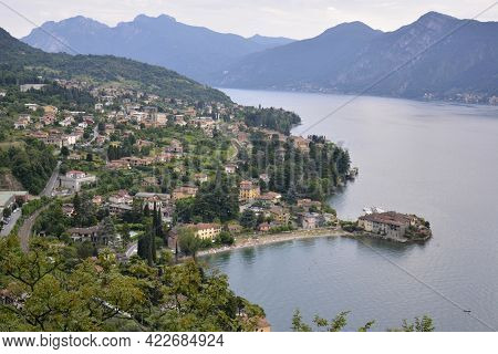 Panorama Of Lierna Mountain Lake Como With Village By Waterfront Surrounded By Green Hills Covered W
