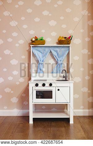 Toy Wooden Kitchen In A Children Playroom