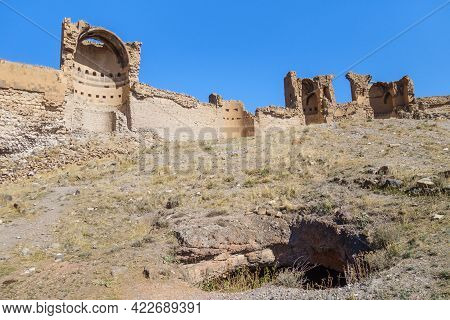 Ruins Of Powerful Walls Of Medieval City Ani, Near Kars, Turkey. Some Underground Building On Front