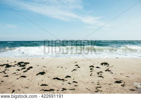Deep Blue Stormy Ocean Water And Blue Sky Background. Horizon Of The Sea