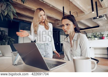 Young Female Boss Scolding Her Female Subordinate For Bad Work Results